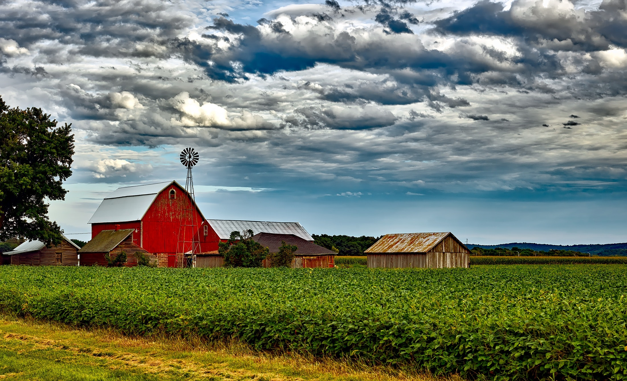 image of a farm, barn, clouds